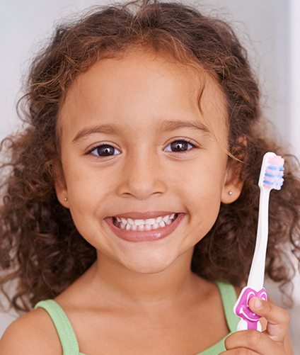 Little girl smiling with tooth brush